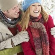 Couple Standing Outside In Snowy Landscape — Stock Photo
