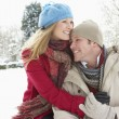 Foto Stock: Couple Standing Outside In Snowy Landscape