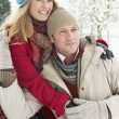 Couple Standing Outside In Snowy Landscape — Stock Photo #4836203