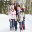 Family Walking Through Snowy Woodland — Stock Photo #4836205