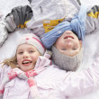 Children Laying On Ground Making Snow Angel — Stock Photo