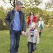 Young Family Outdoors Walking Through Park — Foto Stock