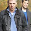 Two Men Standing Outside In Autumn Woodland — Stock Photo