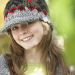 Head And Shoulders Of Young Girl In Autumn Woodland - Stock fotografie