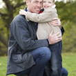 Father And Son Hugging On Outdoor Autumn Walk — Stock Photo