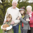 Grandparents With Grandchildren Holding Football Outside — Stock Photo