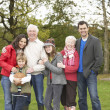 Extended Family Group On Walk Through Countryside - Stock Photo