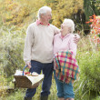 Senior Couple Outdoors With Picnic Basket By Autumn Woodland — Stock Photo