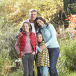 Family Group Standing Outdoors On Wooden Walkway In Autumn Lands — Stock fotografie #4836366