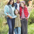 Family Group Standing Outdoors On Wooden Walkway In Autumn Lands — Stock fotografie #4836368
