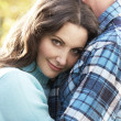 Close Up Of Romantic Couple Embracing By Autumn Woodland — Stock Photo #4836381