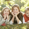 Stock Photo: Group Of 3 Children Realxing Outdoors In Autumn Landscape