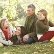 Royalty-Free Stock Photo: Family Group Relaxing Outdoors In Autumn Landscape