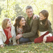 Family Group Relaxing Outdoors In Autumn Landscape — Stock Photo