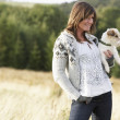Young Woman Outdoors In Autumn Landscape Holding Dog — Stock Photo