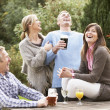 Group Of Friends Outdoors Enjoying Drink In Pub Garden — Stock Photo
