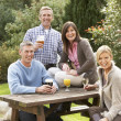 Stock Photo: Group Of Friends Outdoors Enjoying Drink In Pub Garden