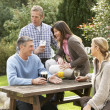 Group Of Friends Outdoors Enjoying Drink In Pub Garden — Stockfoto