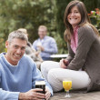 Couple Outdoors Enjoying Drink In Pub Garden — Stock Photo