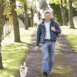 Man Walking Dog Outdoors In Autumn Park — Stock Photo