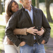 Portrait Of Romantic Couple Enjoying Outdoor Walk Through Autumn — Stock Photo