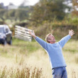 Man Enjoying Freedom Outdoors in Autumn Landscape - Stockfoto