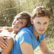 Royalty-Free Stock Photo: Young Romantic Couple Relaxing On Beach Together