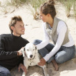 Portrait Of Romantic Teenage Couple On Beach With Dog — Stock Photo