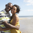 Romantic Young Couple Embracing On Beach — Stock Photo #4836664