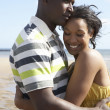 Romantic Young Couple Embracing On Beach — Stock Photo #4836668