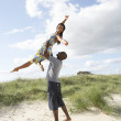Energetic Young Couple Having Fun In Dunes By Beach — Stock Photo