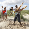 Group Of Young Having Fun Dancing On Beach Together — Stock Photo
