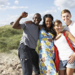 Royalty-Free Stock Photo: Group Of Young Having Fun On Beach Together