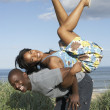 Stock Photo: Energetic Young Couple Having Fun In Dunes By Beach