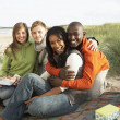 Group Of Young Friends Enjoying Picnic On Beach Together — Stock Photo #4836816
