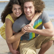 Affectionate Young Couple Having Fun On Beach - Stock Photo