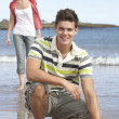 Affectionate Teenage Couple Having Fun On Beach — Stock Photo