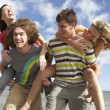 Group Of Young Friends Having Fun On Summer Beach Together — Stock Photo