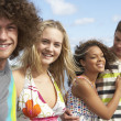 Stock Photo: Group Of Young Friends Having Fun On Summer Beach Together
