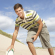 Stock Photo: Teenage Boy With Rugby Ball On Beach