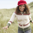 Teenage Girl Walking Through Sand Dunes Wearing Warm Clothing — Stock Photo #4836887