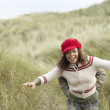Teenage Girl Walking Through Sand Dunes Wearing Warm Clothing — Stock Photo #4836889