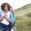 Young Couple Walking Through Sand Dunes Wearing Warm Clothing — Stock Photo