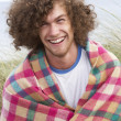 Young Man Standing In Sand Dunes Wrapped In Blanket — Stock Photo
