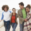 Group Of Young Friends Walking Along Autumn Shoreline — Stock Photo