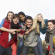 Group Of Teenage Friends Having Piggyback Rides In Autumn Landsc — Stock Photo
