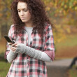Frustrated Teenage Girl Making Mobile Phone Call In Autumn Lands — Stock Photo