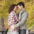 Romantic Teenage Couple In Autumn Park - Stock Photo