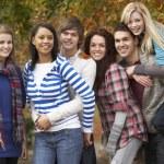 Group Of Six Teenage Friends Having Fun In Autumn Park — Stock Photo
