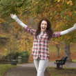 Teenage Girl Standing In Autumn Park With Arms Outstretched — Stock Photo